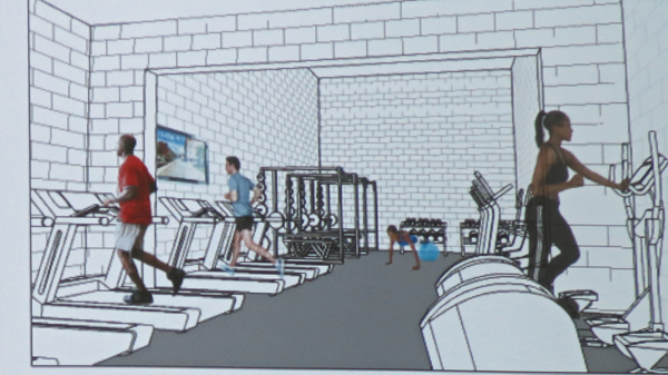 Fitness area now ends at wall that will be opened into old restroom area.