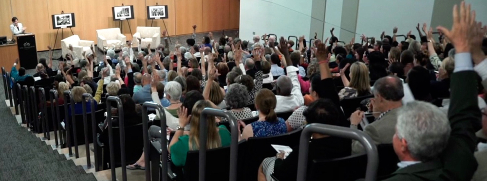 Audience members at UNCC Center City auditorium when asked to raise hands if they were education advocates.