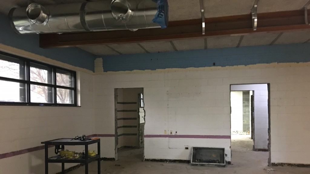 Looking from back of room where Forum met, through old kitchen to second meeting room. Kitchen plumbing has been removed. HVAC ductwork installation has begun on ceiling.